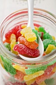 Sour Sweets (jelly sweets, USA) in jar with spoon