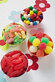 Assorted jelly sweets and bubblegum in bowls