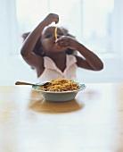 Small girl eating spaghetti bolognese