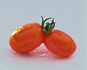Twin tomatoes with drops of water