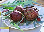 Artichokes with leaves on plate