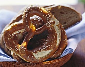 Soft pretzels and slices of bread in a bread basket