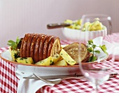 Rolled pork roast with garlic and parsley potatoes