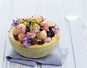 Stuffed melon with pistachios and borage flowers