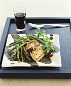 Pork cutlets with green asparagus and plum sauce