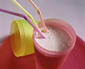 Kefir with syrup in pink beaker