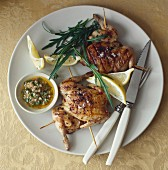 Grilled poussin, herb oil, lemon and rocket