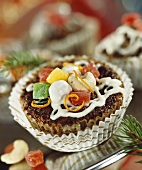 Small cake with candied fruit and nuts for Christmas