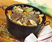 Boiled beef with vegetables in stock pot