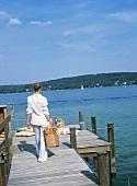 Woman with picnic bag at lakeside