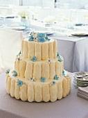 Three-tiered wedding cake with sponge fingers