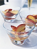 Poached peaches with brandy in syrup