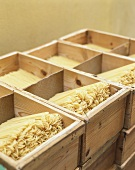 Spaghetti in wooden boxes