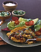 Parmesan schnitzel with red kidney beans and salad