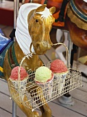 Model horse holding basket containing three ice cream cones