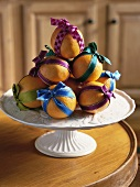 Christmas decoration of oranges with coloured ribbons