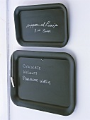 Two blackboards with chalk for kitchen notes