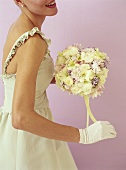 Bride holding bouquet of white roses and lilac