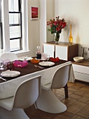 Seventies-style living room with laid dining table