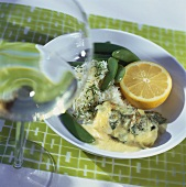 Fish with cheese, sugar snap peas and orange