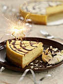 Piece of cheesecake with sparkler