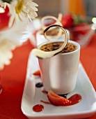 Crème brulee with strawberry jus