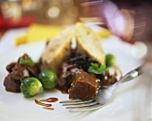 Venison ragout with Brussels sprouts and napkin dumpling