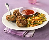 Meatballs with vegetable noodles and spicy sauce