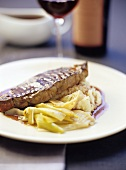 Loin steak with red wine sauce, leeks and parsnip puree
