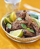 Strips of beef with limes and mint leaves