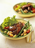 Lamb fillet with mustard seeds on bean salad