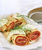 Crepe rolls with salmon filling