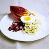 Boiled egg on vegetables