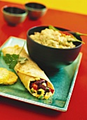 Wrap with vegetable filling and spicy dip