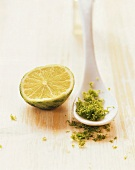Spoonful of grated lime rind and half a lime