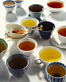 Various teas in small bowls and cups