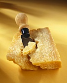 Mature Parmesan cheese with knife