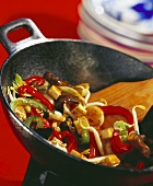 Vegetables with diced tofu in wok