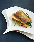 Sea bass with green beans on La Ratte potatoes