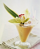 Pineapple and coconut shake with floral decoration