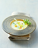 Coconut soup with vegetables in wooden plate