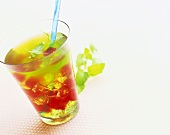 Vodka and lemon drink with red and green jelly