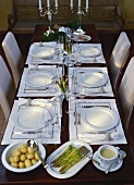 Table laid for asparagus meal