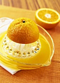 Half an orange on citrus squeezer