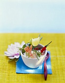 Coconut milk soup with shrimps and chili peppers