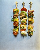 Three skewers with meat and vegetables