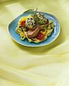 Pork fillets on ribbon pasta