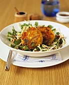Fish cakes on herb and sprout salad