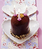 Mini chocolate cake with walnuts and three candles