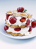 Waffle cake with strawberries and cream